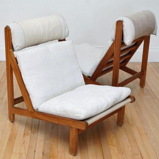 teak lounge chairs pair