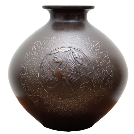 an inlaid bronze vase